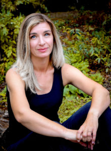 Author Carey Salerno is sitting outside with her arms crossed