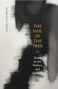 Cover of The Nail in the Tree by Carol Ann Davis. It is white with a dark smudge. The title is in yellow in the dark section.